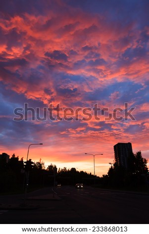 Amazing red sunset and buildings - stock photo