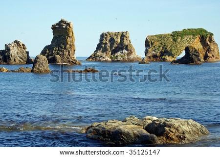 Amazing rocky on headland Velikan,  island Sakhalin - stock photo