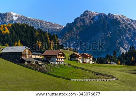 amazing scenery of Dolomites, Italian Alps, View with village - stock photo