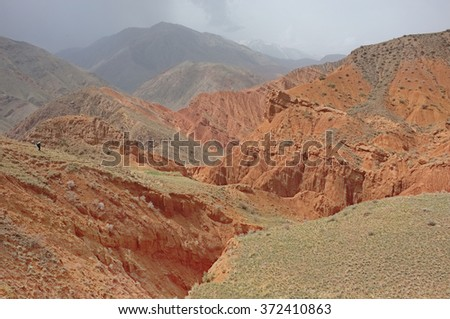 Amazing scenic red mountain valley, canyon Uchterek, Kyrgyzstan, Central Asia. - stock photo