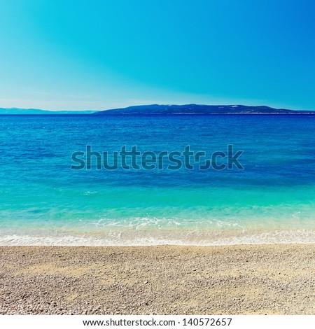 Amazing sea bay blue background - stock photo