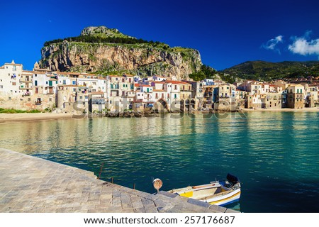 amazing sea-front view of old small town Cefalu in Sicily, Italy - stock photo