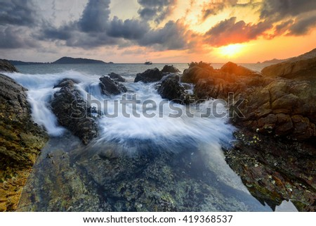 Amazing seascape during sunset with slow shutter technique  at Kalim Beach, Phuket Thailand. - stock photo