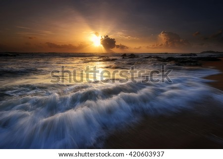 Amazing seascape sunrise at the beach with great motion waves. Nature composition. - stock photo