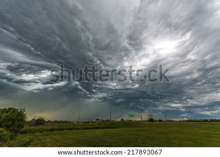 Amazing  Storm Clouds over the freeway - wide angle shot  - stock photo