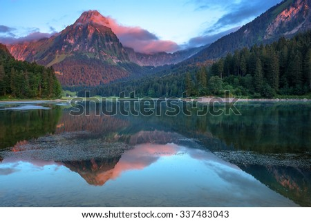 Amazing summer morning on the fantastic Swiss lake Obersee, located near Nafels village. Alps, Switzerland, Europe. - stock photo