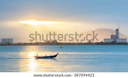 Amazing Sunrise and Sunset with boat in George Town, Penang Malaysia - stock photo