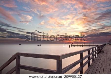 Amazing sunrise at the beach, Machalinki Poland, seaside landscape - stock photo
