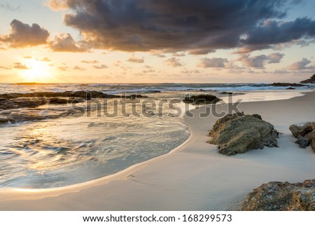 Amazing sunrise colours at the beach on Stradbroke Island, Queensland Australia - stock photo