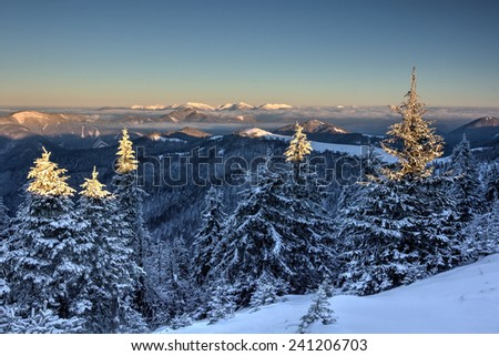 Amazing sunrise in winter Greater Fatra mountains - Little Fatra mountains on the horizon. Slovakia, Europe. - stock photo