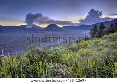 Amazing sunset at Bromo Mount,  East Java, Indonesia. Nature composition, noise effect and soft focus. - stock photo