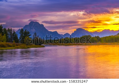 Amazing Sunset over Grand Tetons taken from the Oxbow Bend Turnout - stock photo