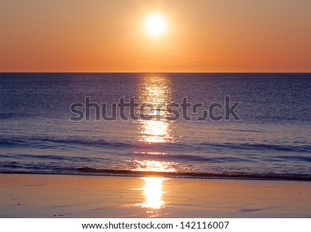 Amazing sunset over the German North Sea, shot from a beach on Sylt island - stock photo