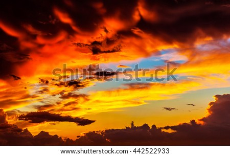 Amazing sunset sky background, red dramatic cloudscape, overcast weather, sun down, dreamy evening - stock photo