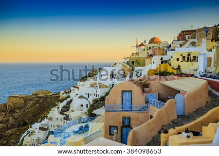Amazing sunset view in Oia village on Santorini island in Greece.  - stock photo