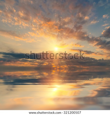 Amazing sunset with sun and clouds, beautiful ocean - stock photo