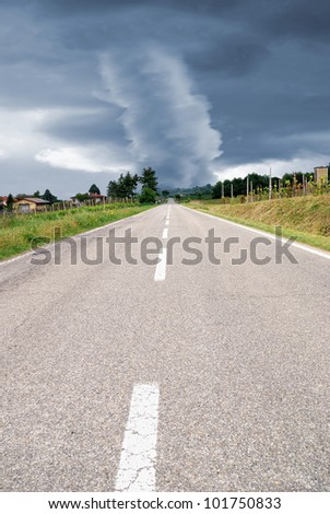 amazing tornado at the end of the road - stock photo