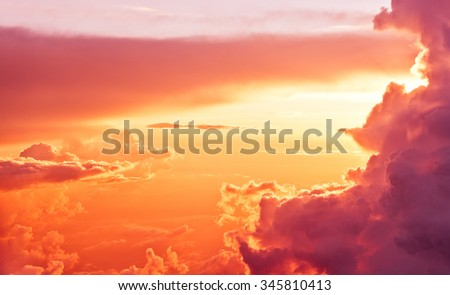 Amazing view from plane on sunrise sun and clouds - stock photo