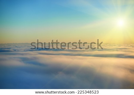 Amazing view from plane on the sky, sunset sun and clouds - stock photo