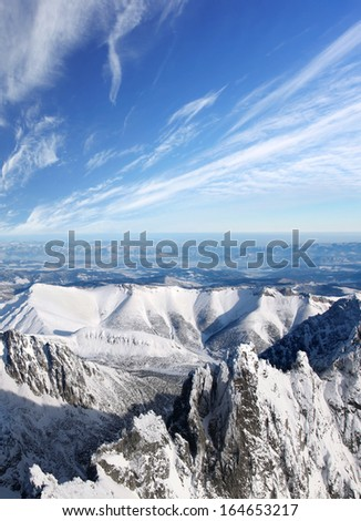 Amazing view of High winter Mountains against  blue sky  - stock photo