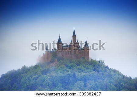 Amazing view of Hohenzollern castle in haze during summer time in Germany - stock photo