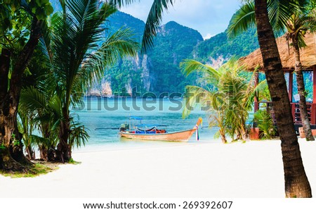 Amazing view of the coast of the island of Phi Phi Don with long tail boat, Thailand - stock photo