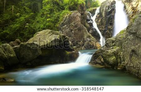 Amazing view of waterfall in Retezat Mountains - stock photo