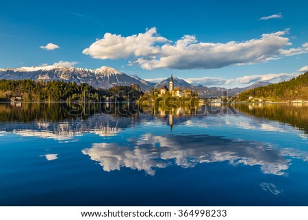 Amazing View On Bled Lake, Island,Church And Castle With Mountain Range (Stol, Vrtaca, Begunjscica) In The Background-Bled,Slovenia,Europe - stock photo