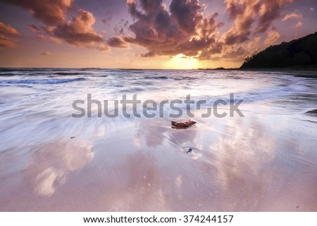 Amazing view seascape during sunset with slow shutter technique - stock photo