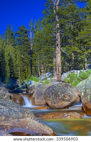 Amazing Water Streams Shot in Yosemite National Park in California. Long Shutter Speed Used.HDR Toning. Vertical Image - stock photo