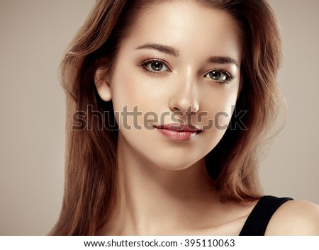Amazing woman portrait. Beautiful girl with long wavy hair. Brunette model with hairstyle - stock photo