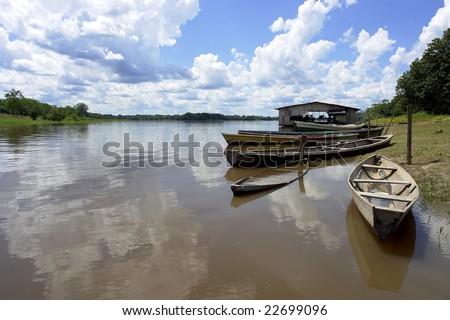 Amazon river native community boat pear - stock photo
