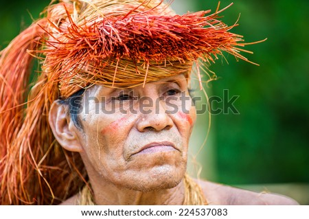 AMAZONIA, PERU - NOV 10, 2010: Unidentified Amazonian indigenous man portrait. Indigenous people of Amazonia are protected by  COICA (Coordinator of Indigenous Organizations of the Amazon River Basin) - stock photo