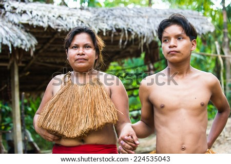 AMAZONIA, PERU - NOV 10, 2010: Unidentified Amazonian indigenous people. Indigenous people of Amazonia are protected by COICA (Coordinator of Indigenous Organizations of the Amazon River Basin) - stock photo