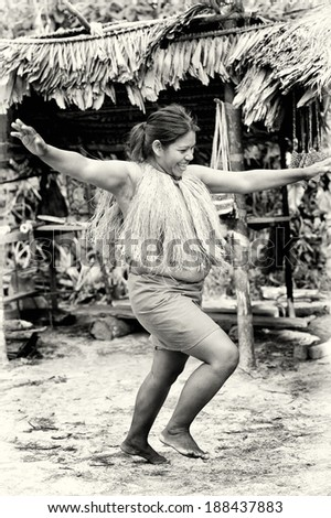 AMAZONIA, PERU - NOV 10, 2010: Unidentified Amazonian indigenous woman dances. Indigenous people of Amazonia are protected by  COICA (Coordinator of Indigenous Organizations of the Amazon River Basin) - stock photo