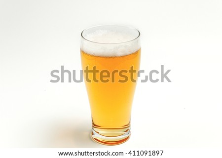 amber beer in pint glass on white background - stock photo