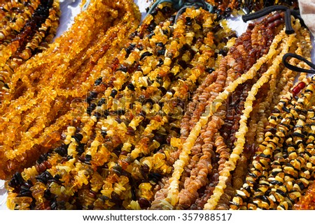 Amber jewellery on display on stall in Krakow, Poland - stock photo