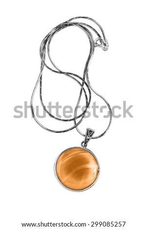 Amber medallion on silver chain on white background - stock photo