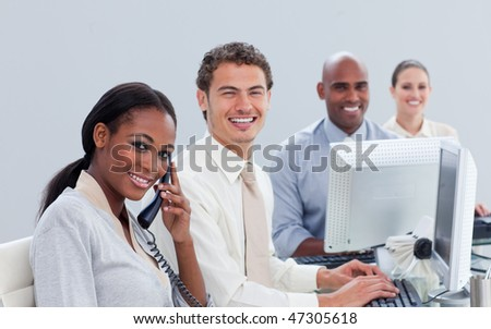 Ambitious business team at work in the office - stock photo