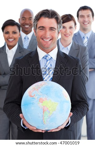 Ambitious business team showing a terrestrial globe against a white background - stock photo