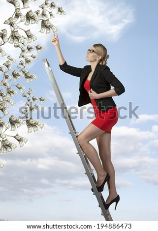 ambitious business woman climbing ladder for success  - stock photo