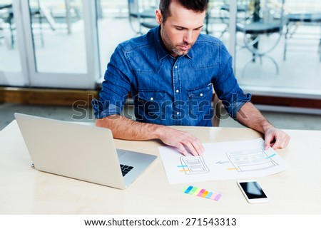 Ambitious web designer designing a responsive website - stock photo