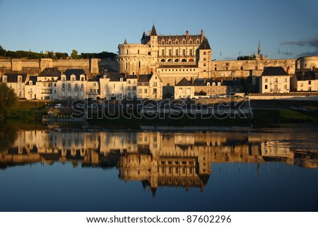 Amboise castle at sunset light and its reflection in Loire river (Loire Valley, France) - stock photo