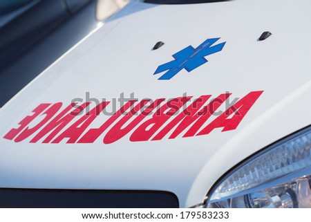 Ambulance sign of the car - detail. - stock photo