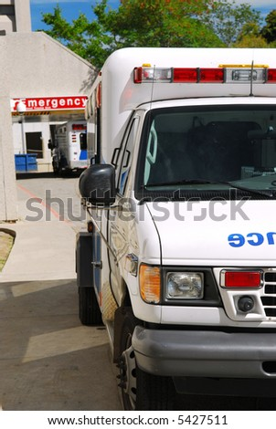 Ambulance vehicle in front of an emergency entrance to a hospital - stock photo