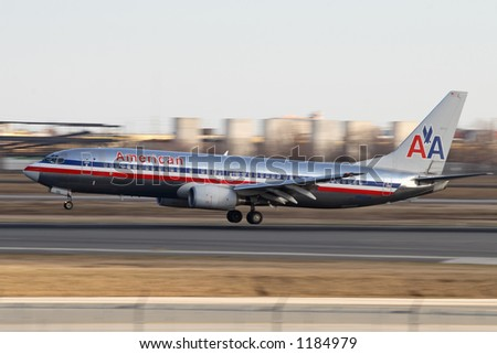 Amerian Airlines landing with a blurry background. - stock photo