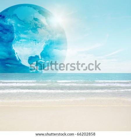 America globe on tropical beach. Map from NASA imagery - stock photo