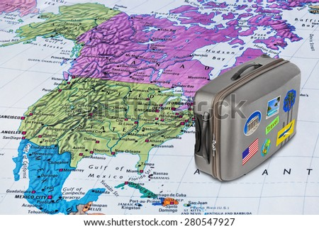America map and case with stickers (my photos) - travel background - stock photo