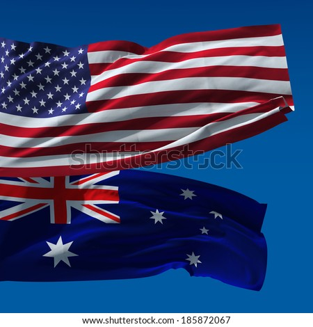 American and Australian national flags waving upon blue sky - stock photo