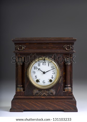 American Antique Clock Made in the 1890's. - stock photo